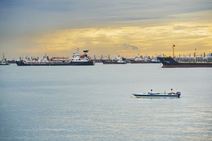 Wolf Nitschke posted a photo:  Sunrise Shots into the straits of Malacca. City of ships.