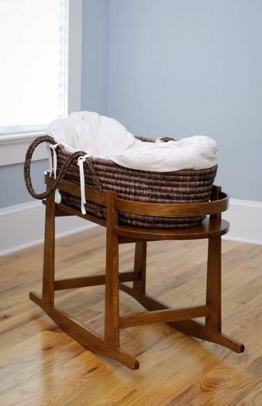 Perfect Bassinet - cradle and moses basket! Too bad this link doesn't work...will have to keep an eye out for one like it!