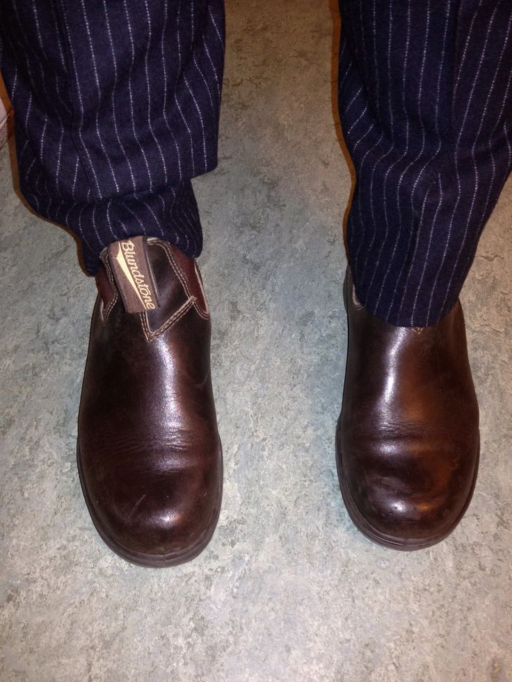Blundstone boots and pinstripe trousers, Stockholm, Sweden. Photo Sara Lüdtke