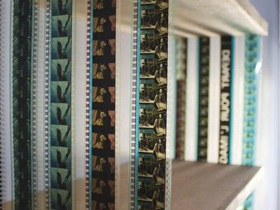 Minimalistic Collapsable, Hanging Bookshelf Made with Recovered 35 mm Film - wouldn't this be perfect for a DVD shelf?