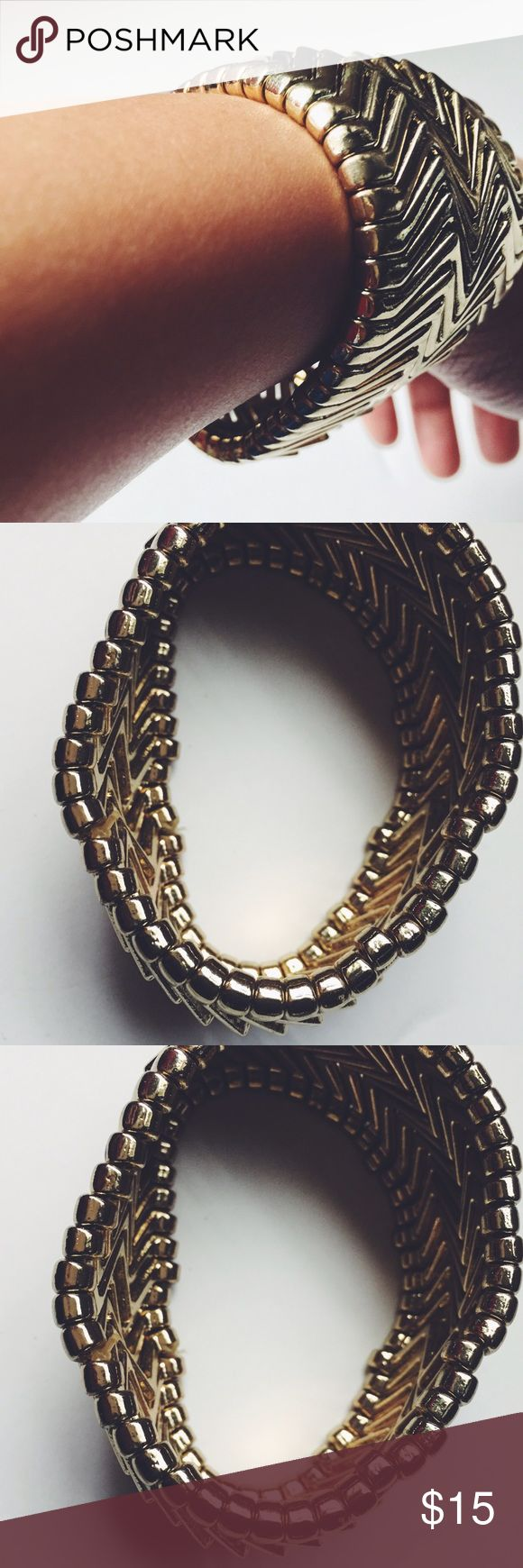 Chevron bracelet. Gold-like color with chevron detail. Stretchy and perfect for layering. Not made out of real gold. Jewelry Bracelets