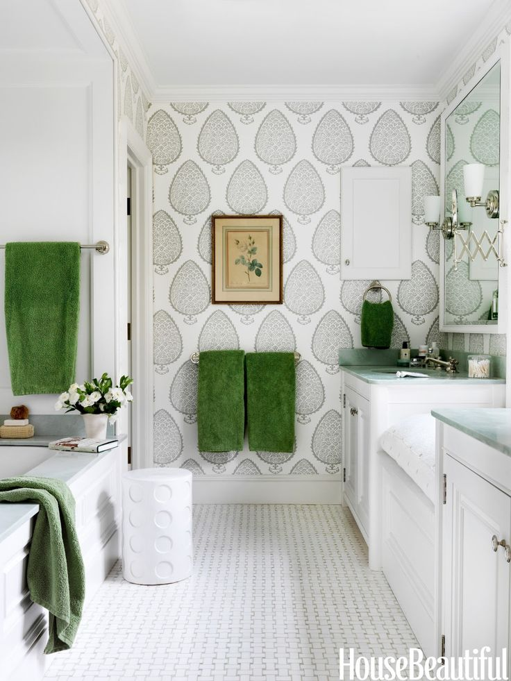 Splendor in the Bath. A large-scale pattern on the wallcovering by Katie Ridder for Holland & Sherry  makes the master bath feel bigger. Interior Designer: Connie Newbury.