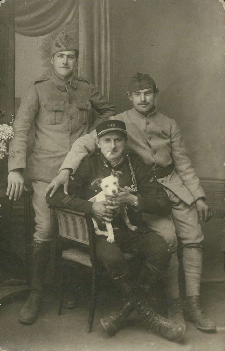 Three (French) soldiers and their pet mascot war dog, WWI