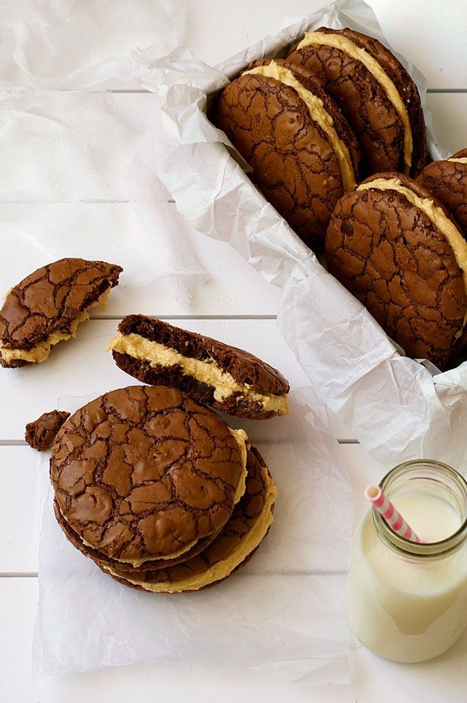 Brownie Cookie Sandwich with Peanut butter Frosting - fudgy, moist cookies that taste just like brownies filled with a fluffy peanut butter frosting.