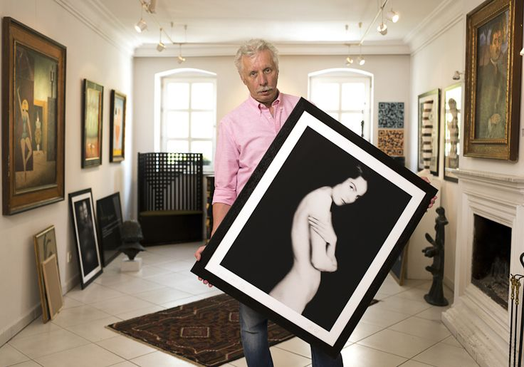 Tóth György - Famous hungarian photographers posing with their most iconic works.