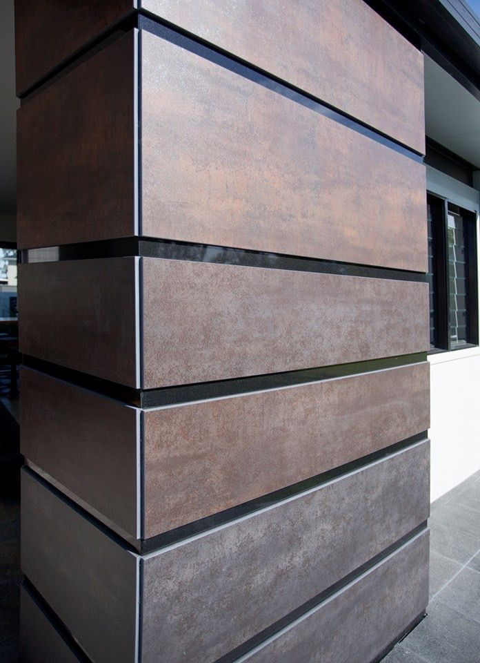 With shows like The Block in front of people designers are always looking for something different. This fireplace is clad in 12mm Neolith Iron Grey (bottom 2 panes) Iron Copper (Middle 2) Iron Corten (Top 2) set on Jet Black Granite feature strips. These surfaces replicate metal finishes without the worry of unsightly rust stains washing onto your paths.
