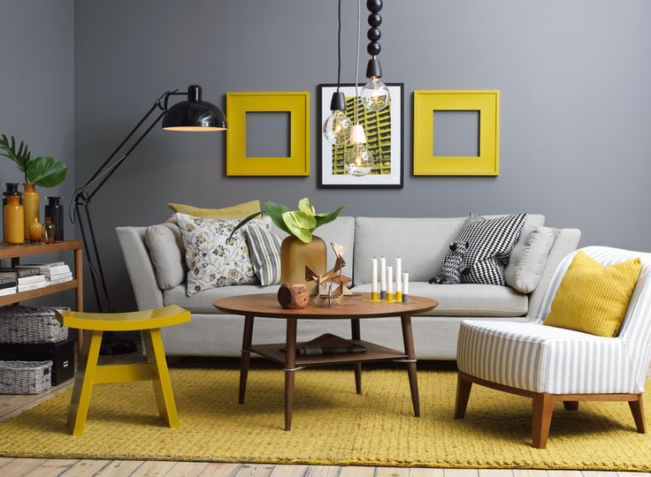 ~crimson, teal, or coral instead of yellow~ Mix and Chic: February 2011. Gray sofa accented with shades of yellow. Casual and contemporary living room.