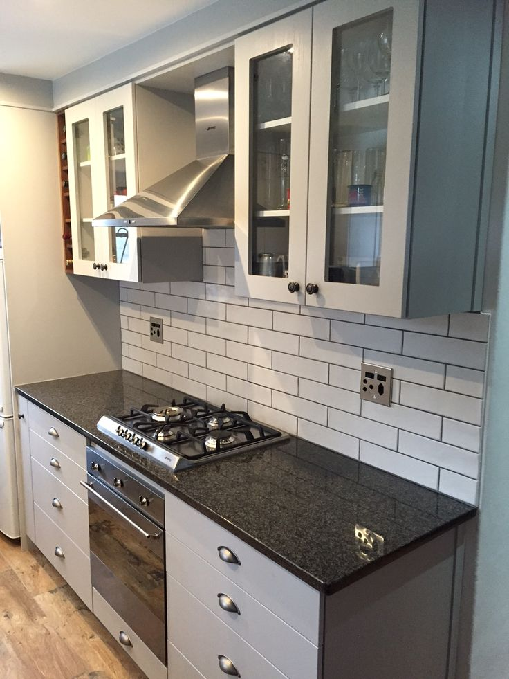 White Kitchen And Tiles Wall Grey