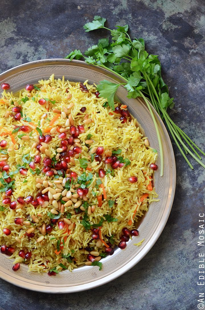 This recipe for Jewel-Toned Sweet and Savory Basmati Rice Pilaf with Pomegranate made with @swansonbroth is an impressive-looking side dish that's easy to make and pairs well with just about anything! #spon