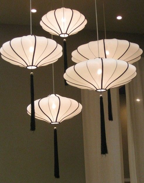 Asian paper lanterns with tassels are genius to add an Eastern flavor
