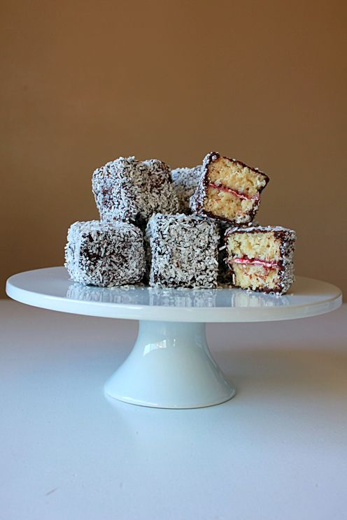 Lamingtons - Austrailian dessert of white cake with raspberry jam, dipped in chocolate and dusted with coconut!