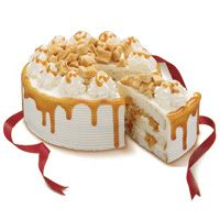 Coffee Crunch by RED RIBBON  Price:  US$49.99  Three (3) layers of white chiffon cake filled with cream and crunch in between layers; iced with whipped cream; topped with crunch and decorated with caramel gel drippings. This delectable cake is approximately 8 inches in diameter.