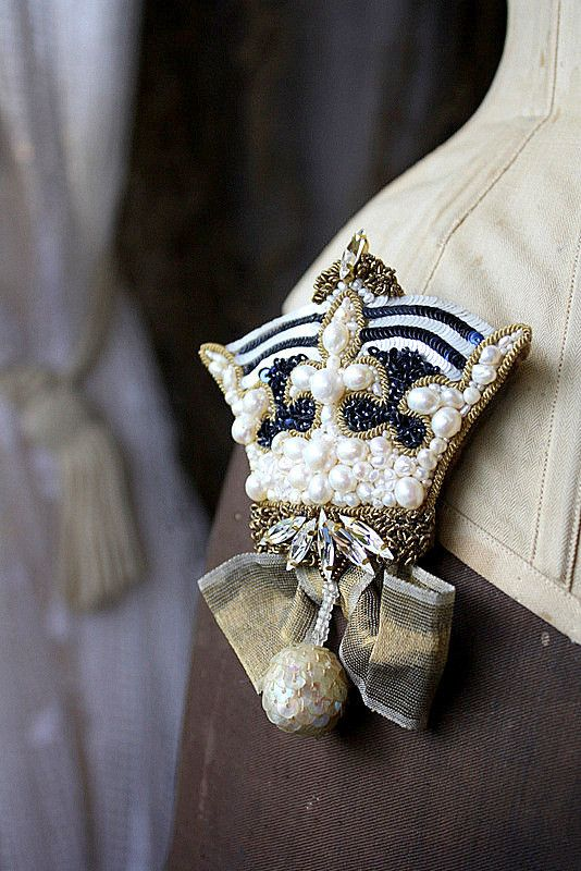 stitched crown brooch