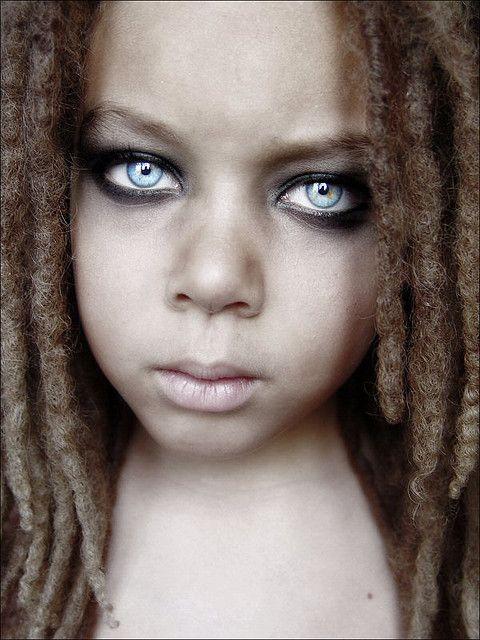 Black child with amazing blue eyes and locks