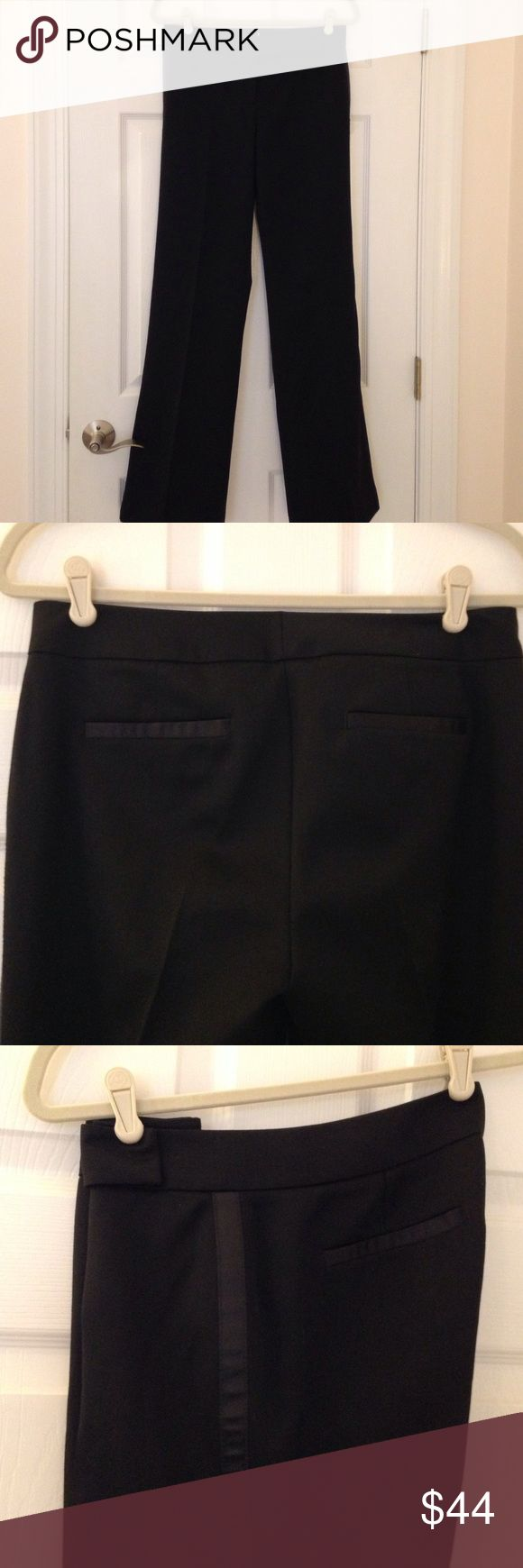 JCrew Black Tuxedo Stripe Pants in Size 4 JCrew Black tuxedo stripe pants in Favorite fit. These pants are size 4, never worn and still have some of the tags. They are made of 100% virgin wool and also lined in black 100% acetate. They have a black tuxedo stripe down the sides and this also accents the back pockets. J. Crew Pants Trousers