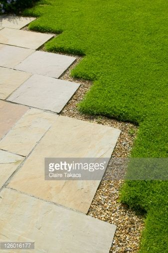 Stock Photo : Paving with uneven lawn edging, The Lowes Garden, The Coach House, Haslemere, Surrey, UK