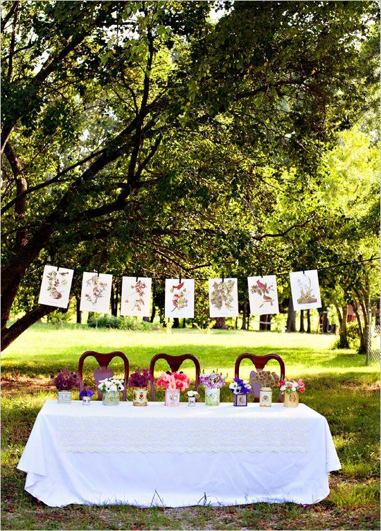 sweet wedding tableOutdoor Wedding, Old Book, Wedding Ideas, Vintage Tins, Book Pages, Outdoor Parties, Flower Vases, Outdoor Tables, Floral Arrangements