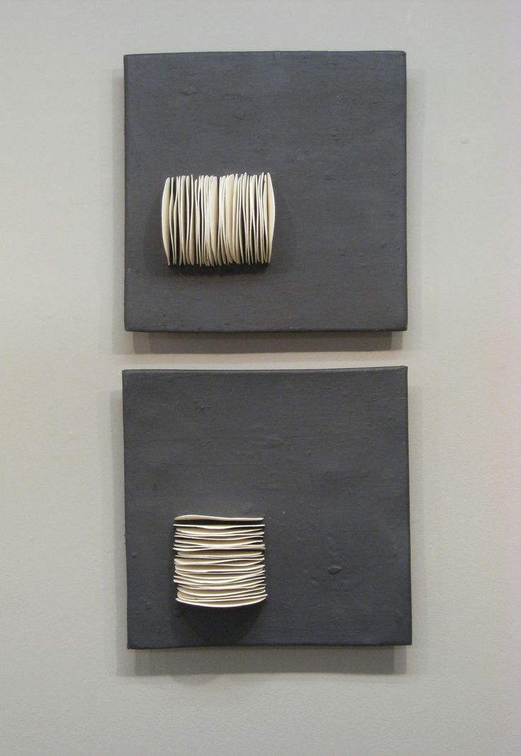 Pair of Dimensional Squares by Lori Katz. Slab-built stoneware with slip. each square is backed on wood and hangs simply from a picture hook on wire across back. Dimensions refer to arrangement, as shown.
