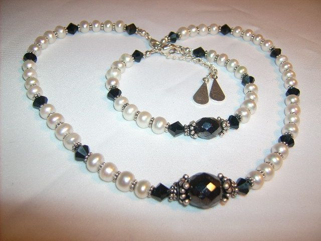 Necklace of sweetwaterpearls, Swarovski, hematite and silver