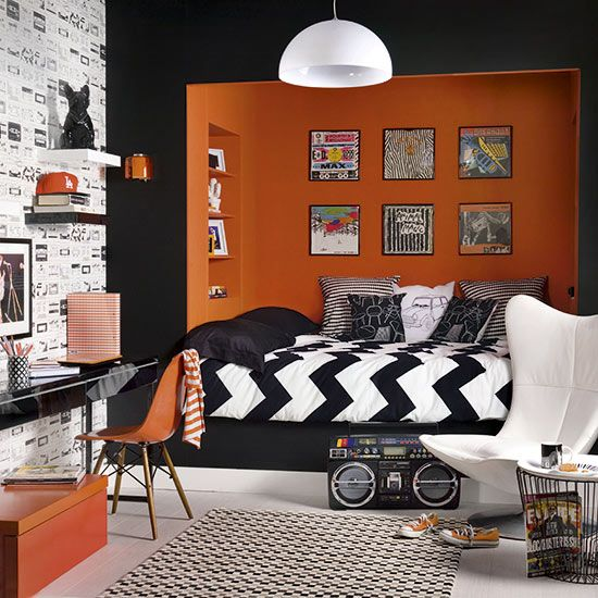 Shock Halloween horror! Power struggles are a common feature of life with teenagers, but this bold retro-style bedroom should help restore the balance. Not only does it feature plenty of black (a favourite with young rebels) but the equally strong orange hues offer parents a secret power: it's known for lifting moods and encouraging communication.