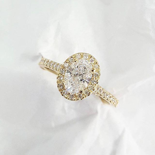 18ct yellow gold oval diamond halo engagment ring. The photo still doesn't quite do the diamond justice!    #handmade #custommade #custom #bespoke #jewellery #jewelry #engagmentring #engagement #diamond #diamonds #oval #ovaldiamond #yellowgoldengagementring #yellow #wedding #mirai
