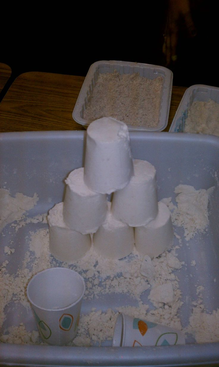 Moon sand. Just 8 cups of flour and 1 cup of baby oil, really soft and easy to clean up.