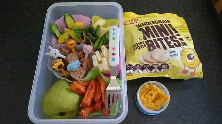 Sweet potato fries, camembert cheese, sugar snap peas, baby asparagus, baby corn, baby zucchini, button squash, beef and vegetable sausage, pear,  mini brown rice cakes and spiced carrot dip.