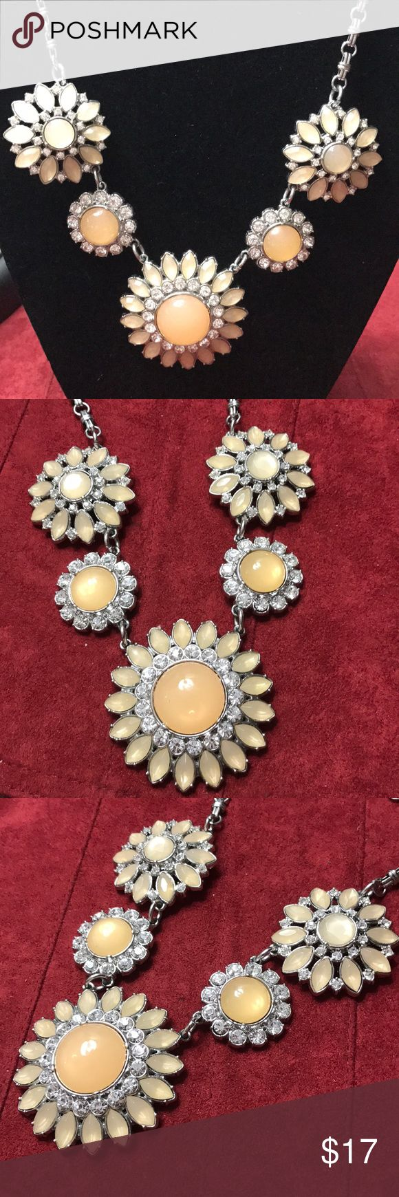 Flower statement necklace - Lia Sophia Bold statement necklace from Lia Sophia.  5 crystal flowers with light peach colored stones and crystal accents!  Beautiful piece!  Hangs 16 inches (also has an additional 3 inch extender).  Biggest flower is 2 inches. Lia Sophia Jewelry Necklaces