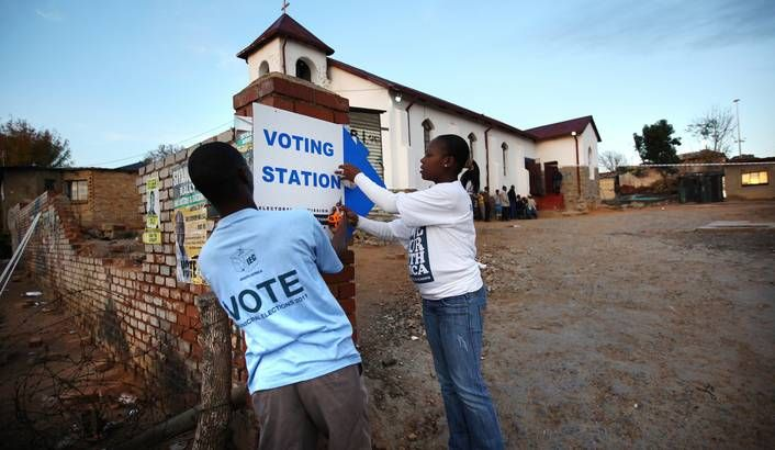 Photo: Independent Electoral Commission (IEC) voting officials prepare a voting station for some of the millions of South Africans to vote in the early morning light at a church in the poor slum of Alexandra Township for the local elections, Johannesburg, South Africa, 18 May 2011. EPA/KIM LUDBROOK