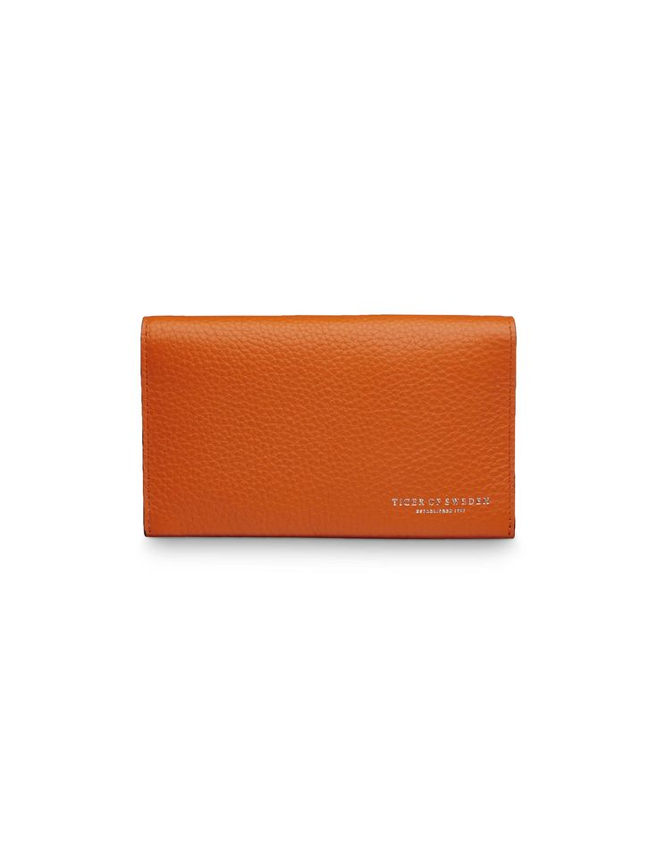 Serla wallet - Women's wallet in medium grain leather. Printed Tiger of Sweden logo on front. One open pocket on back panel. One open pocket and seven card slots on front inside. Two open pockets, one zip pocket and two big card slots on back inside. Size: 15.5 x 9 cm.