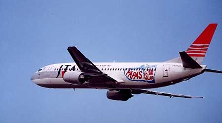 Japan TransOcean Air (JP) Historic fleet Boeing 737-4K5 JA8930 aircraft, with the sticker ''PAPAS island in a shoe shape'' on the airframe, on short final to Japan Okinawa Naha Airport. (Papas island=one of Ogasawara islands).