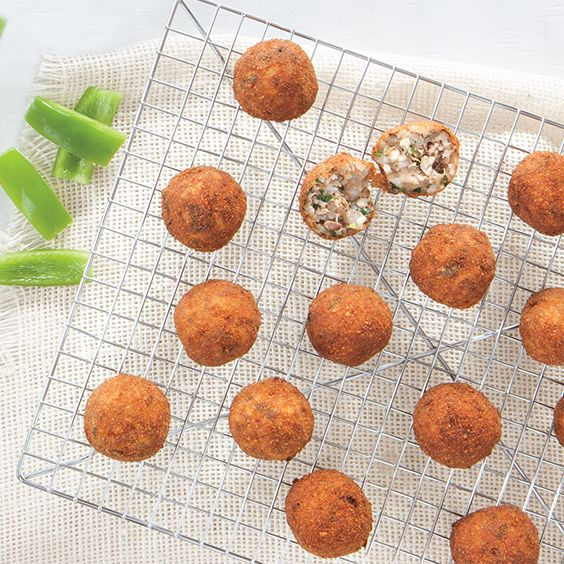 """Fried Boudin Balls - """"Here is a basic recipe I often use, but feel free to experiment. You can decrease the amount of pork liver and increase the amount of pork shoulder if you like. I like to add lots of green onion and flat-leaf parsley along with bits of garlic. Make it your own."""" -Marcelle Bienvenu"""