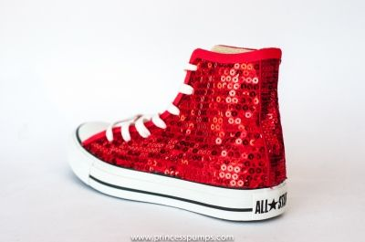 Devotees of rosy colors can grab pink glitter Converse kicks, such as Chuck Taylor All Star Dainty shoes in a sparkling low-top design. Or, go passionately plum with glittery purple Converse sneakers in that iconic but retro high-top style that stops just above the ankles.