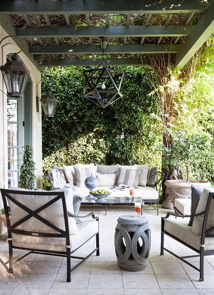 We could extend the ceiling of the covered area, with a pergola... hmmmm....