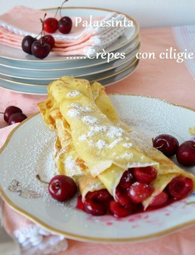 Hungarian Crepes (palacsinta) stuffed with canned cherries