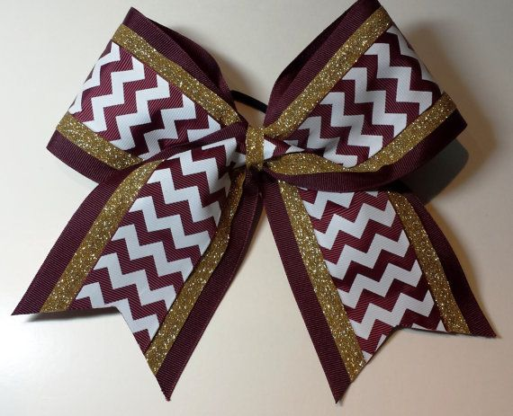 Gold sparkle ribbon paired with maroon chevron over 3 inch wide maroon ribbon. All bows have attached ponytail holder. Bows are only shipped in boxes.