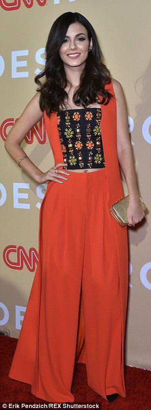 Hitting the stage: Also presenting were Nickelodeon starlet Victoria Justice clad in orang...