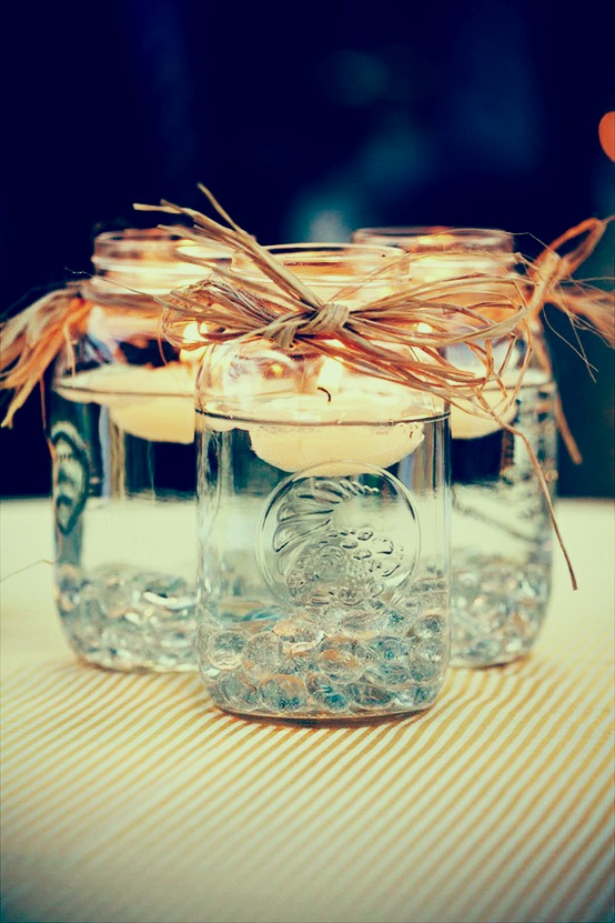 Simple and sweet  #candles #centerpiece with a skinny vase of baby's breath in the middle?