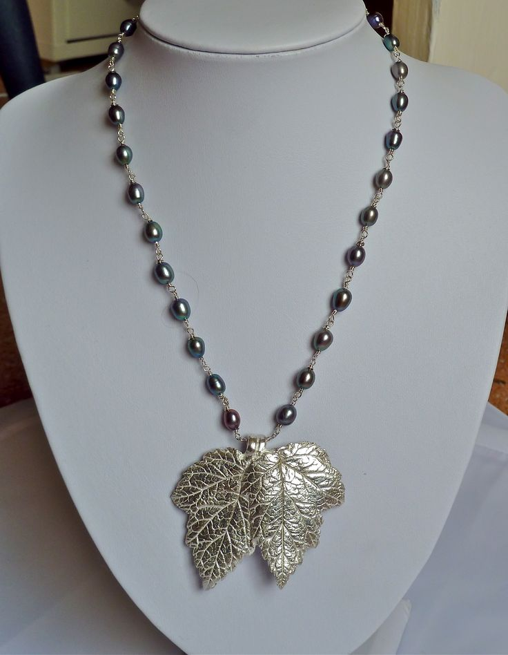 Designed and made by Nuit Nuit. Pure silver (.999) double leaves with a black pearl and silver wire necklace