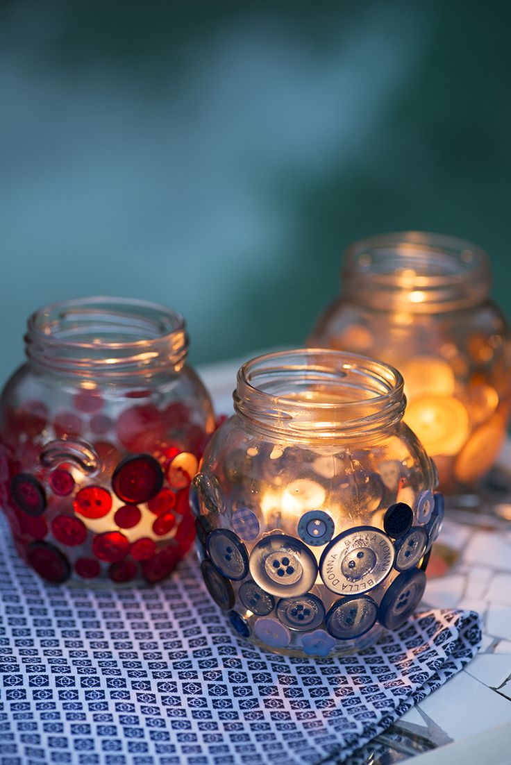 Button tea light holders | Stick buttons all over recycled jars with clear glue for a colourful, stained glass effects when you place candles inside.