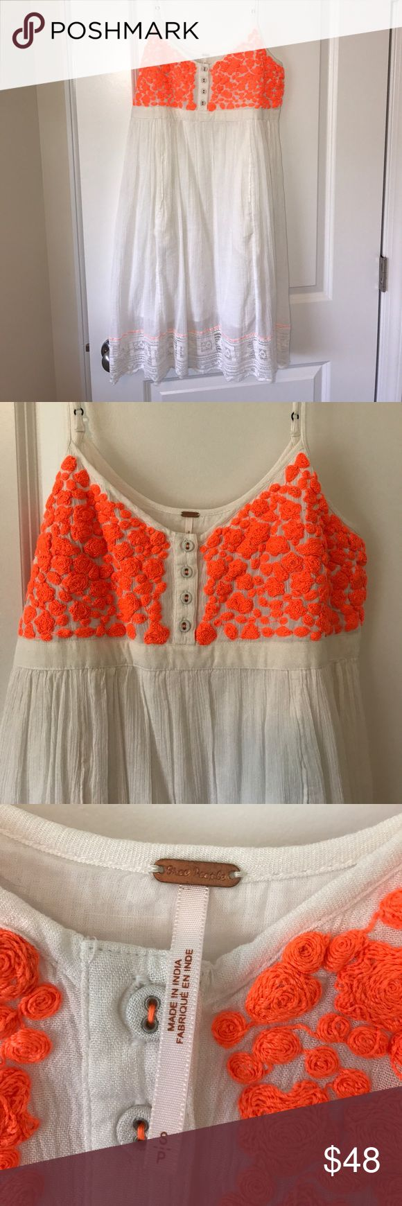 Free People white & orange dress! Free people white & bright orange sun dress! Beautiful detailing on the top with lace on the bottom. Dress has two hidden pockets in the front. Never worn, NWOT. Free People Dresses Midi