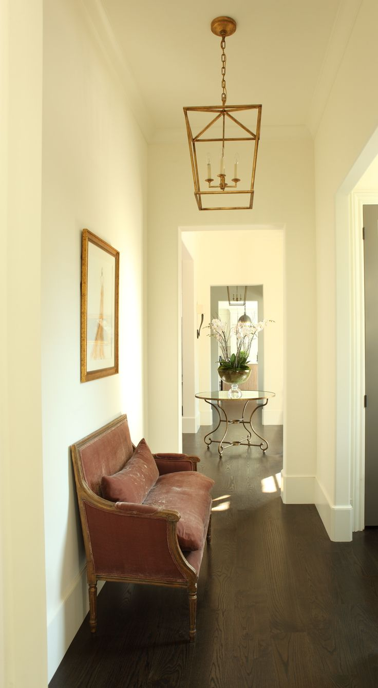 Classic timeless elegance in this front  hallway to the foyer. Hedgewood custom home.