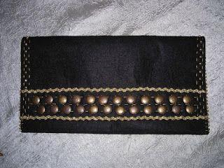 http://kardelencraft.blogspot.com.tr/2012/12/siyah-kece-portfoy.html