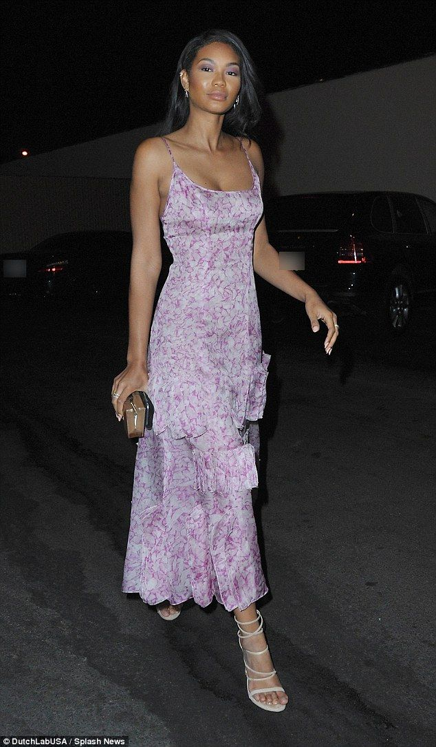 Bloomin' lovely! Chanel Iman donned a low-cut floral pink-purple dress from Carolina Herrera for dinner at Cecconi's on Thursday in Beverly Hills