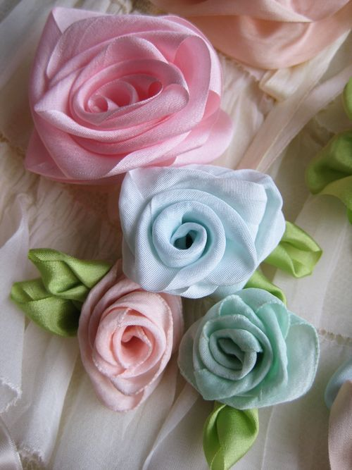 DIY:: Beautiful Shabby Ribbon Flowers Tutorial. Whether a single bloom or a cluster of fabric flowers, these would make a lovely favor (headband? bracelet? necklace?) for girls of all ages.