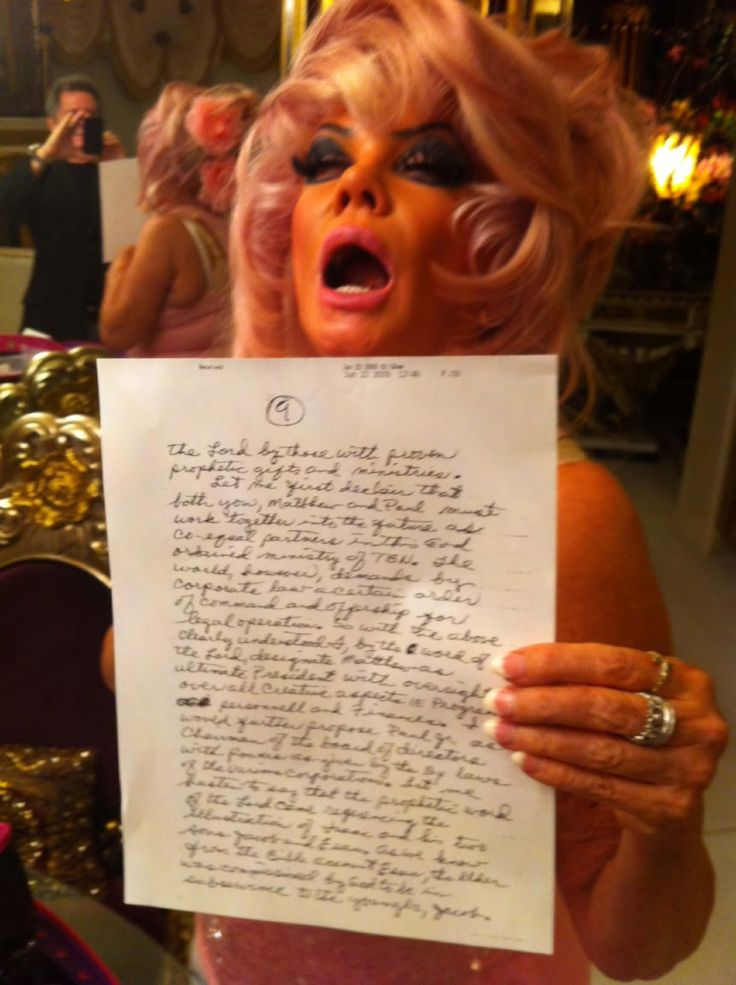 Jan Crouch | SLAUGHTER OF THE SHEEP In this photo, she is mocking her late husband Paul Crouch, by reading his will out loud. Her, son, is in the mirror laughing, and taking the photo. This, was presented in court, along with many other allegations..