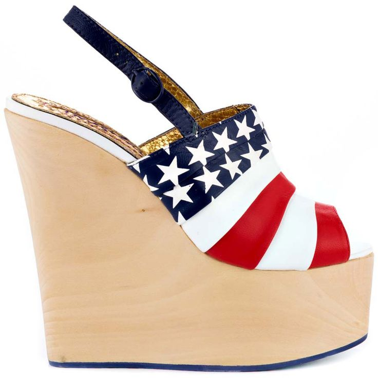Slip into these patriotic wedges from Irregular Choice. Chica Chola has a light 6 inch wood heel with a 2 inch platform. An adjustable navy strap with American flag printed leather upper completes this alluring wedge.