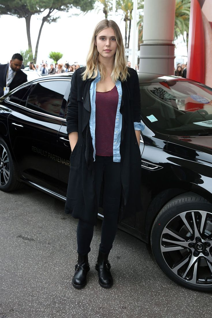 Gaia Weiss wears a burgundy tee with black jeans and a chambray shirt.