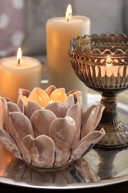 I love the cream coloured candles at the back. They would look great in my make up table. Very vintage.