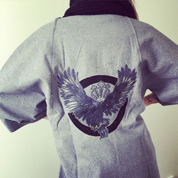 Grey three quarter trench with super cute eagle detail.